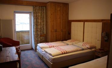 Chata DOLOMIA_dvoulůžkový pokoj s 1 přistýlkou